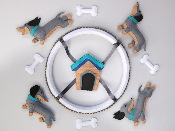 Dachshund dog baby mobile top view