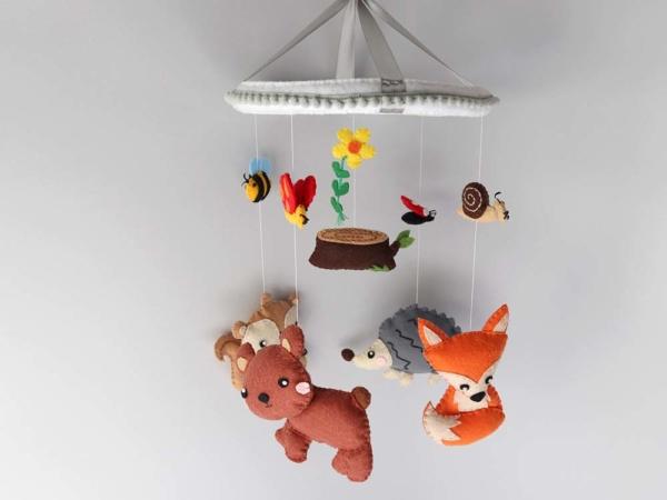 woodland nursery baby mobile hanging position