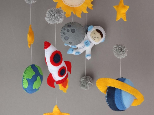 space themed crib mobile hanging position